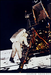 Buzz Aldrin climbs down the Eagle's ladder to the lunar surface.