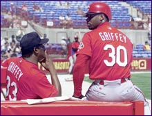 Ken Griffey Sr. sits with his son, Ken Griffey Jr.
