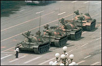 A Chinese Man Stands Alone to Block a Line of Tanks Heading East on Bejing's Cangan Blvd in Tiananmen Square on June 5, 1989
